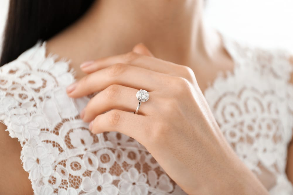 engagement ring and wedding dress